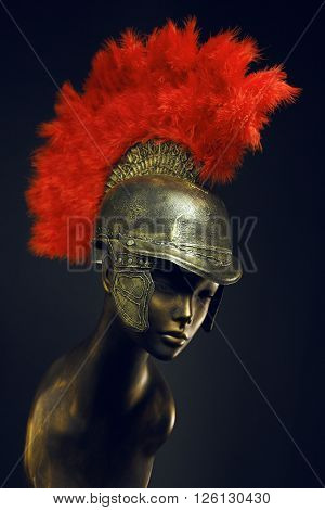 Mannequin in gladiator helmet with red plume