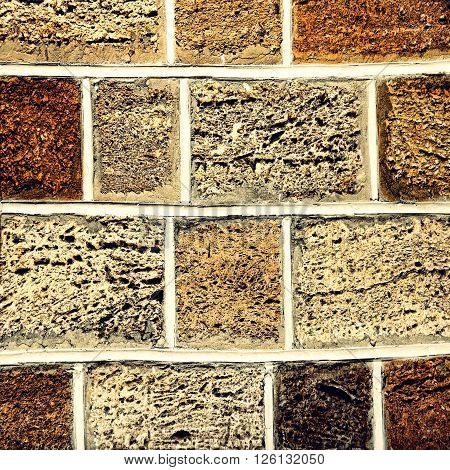 Limestone brick wall taken closeup as abstract background.