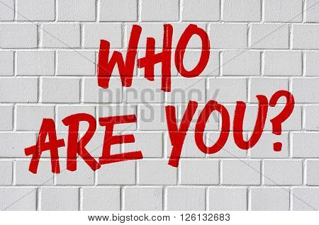 Graffiti On A Brick Wall - Who Are You?