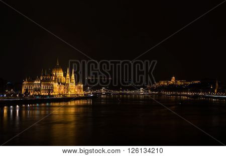 View of Hungarian Parliament Building, Royal Palace and Danube river from Margit bridge at night