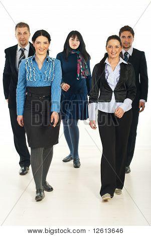 Walking Team Of Business People