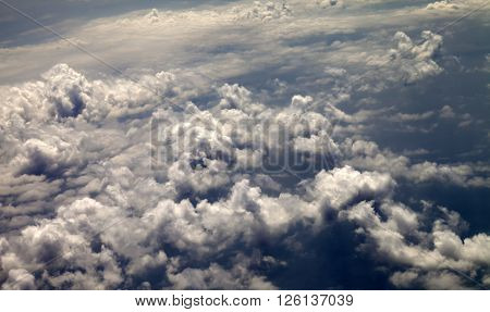 Top view on evening sunlight clouds .
