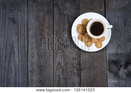 Coffee espresso on background stylish background with amaretti biscuits