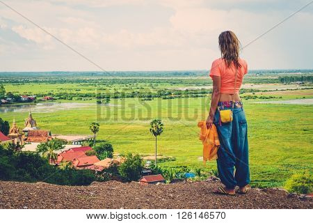 Woman standing on top of a hill enjoying Floating village view, Phnom Krom, Siem Reap, Cambodia
