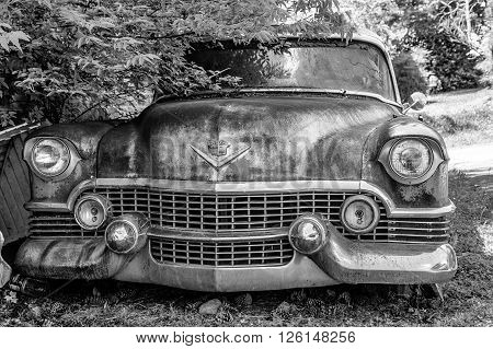 DETROIT MICHIGAN - May 11 2015: Wreck of a vintage Cadillac. The logo has changed but this original was based on coat of arms for Le Sieur Antoine De La Mothe Cadillac the man who founded Detroit