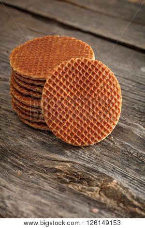 Sweet wafer cookies set on old wooden surface
