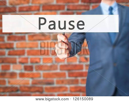 Pause - Businessman Hand Holding Sign