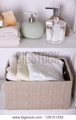 Bathroom set with towels, dispensers and sponges on a light shelf