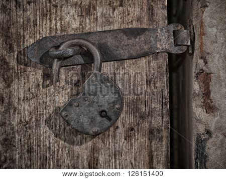 Grange lock on wooden door