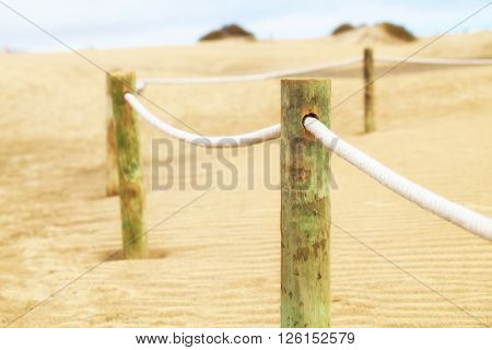 Fence in sand desert