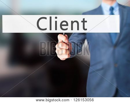 Client - Businessman Hand Holding Sign