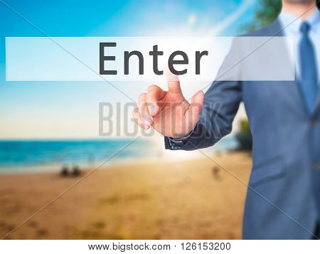 Enter - Businessman Hand Pressing Button On Touch Screen Interface.