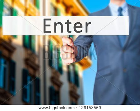 Enter - Businessman Hand Holding Sign