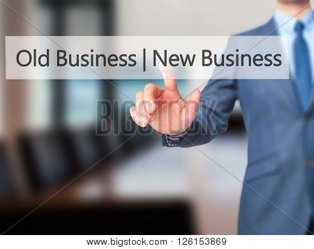 Old Business  New Business - Businessman Hand Pressing Button On Touch Screen Interface.