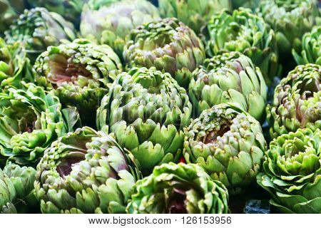 This is a close up photo of artichokes .