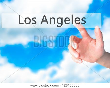 Los Angeles - Hand Pressing A Button On Blurred Background Concept On Visual Screen.