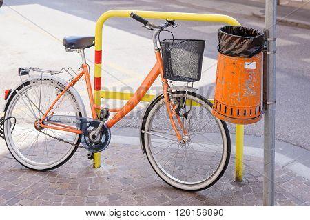 Trash metal orange waste of road and bicycle