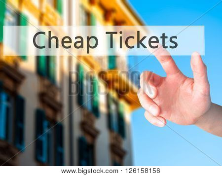 Cheap Tickets  - Hand Pressing A Button On Blurred Background Concept On Visual Screen.