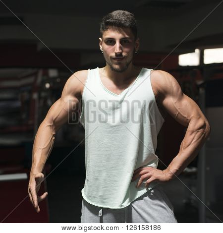 A young muscular athlete man at gym