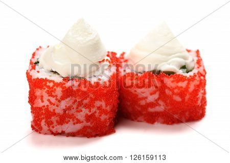 Homemade sushi with red tobiko and cream cheese isolated closeup