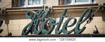 Hotel sign on a building in a city