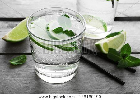 Glass of lemon soda on rustic wooden table