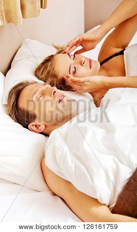 Couple in bed,man snoring woman can't sleep