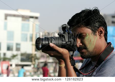 HYDERABAD,INDIA-MARCH 20:Indian photographer take photo of an event on March 20,2016 in Hyderabad,India.