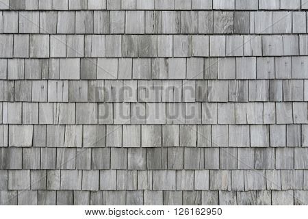 Clapboard house. Grey wooden background for decoration items.