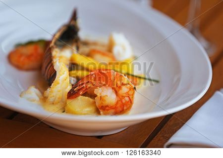 Seafood dish on a wooden table.