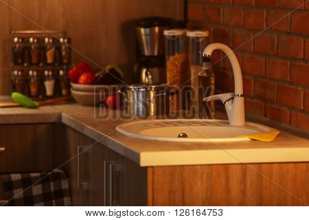 Modern kitchen furniture with sink and utensils