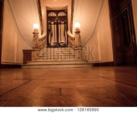 Hardwood floor in a hallway leading to stairs