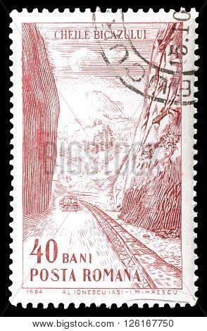 ROMANIA - CIRCA 1964 : Cancelled postage stamp printed by Romania, that shows road through gorge.