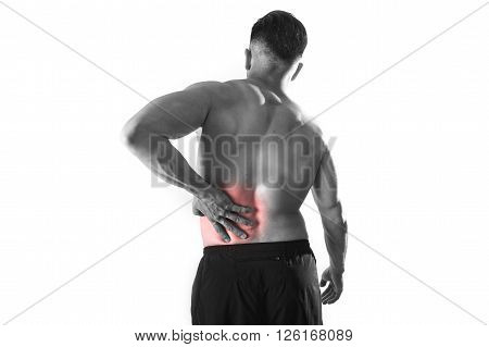 young muscular body sport man holding sore low back waist with hand suffering pain in athlete stress and health care concept isolated black and white red spot injury