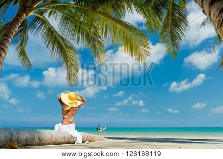 Woman enjoying her holidays on the tropical beach
