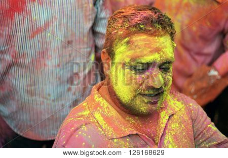 Portrait of a Hindu man celebrating Holi festival smearing colored powder a tradition on March 24,2016 in Hyderabad,India