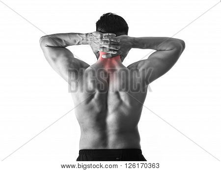 back of young muscular sport man holding sore neck with hands touching or massaging cervical area suffering body pain in spine back health problem isolated black and white red spot injury