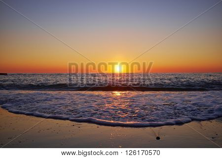Nice sunset on the beach of the Black Sea