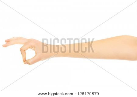 Woman hand gesturing OK sign