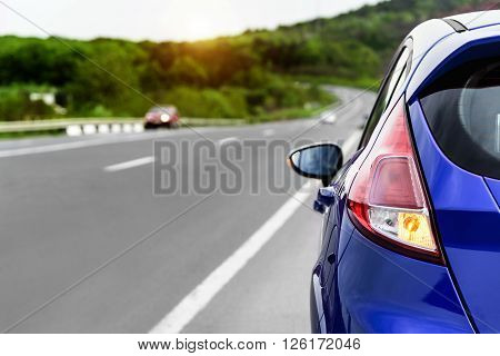 Blue car parked on the roadside. Travel concept.