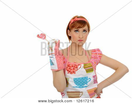 Beautiful Housewife Woman With Lollipop. Studio Shot. Isolated On White Background