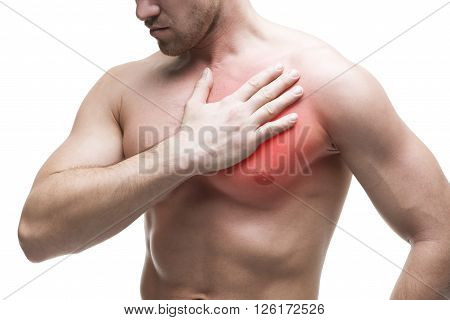 Heart attack. Young muscular man with chest pain isolated on white background with red dot
