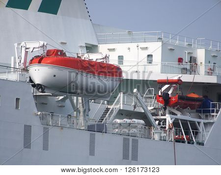 rescue lifeboat of ferryboat on sky background