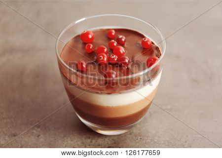 Delicious dessert with rowan in glass