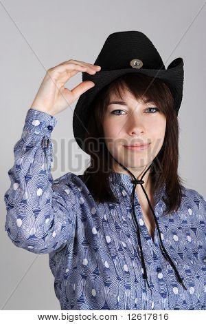 Portrait Of Young Western Cowgirl In Black Hat And Blue Shirt