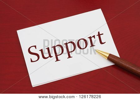 Where to get support White Greeting card with text Support on a red wood background