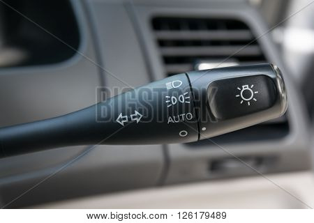 Car interior with light switch,  toggle, transportation, wheel