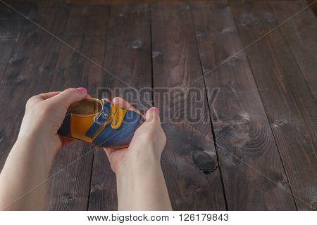 Future Parents Holding A Pair Of Little Shoes