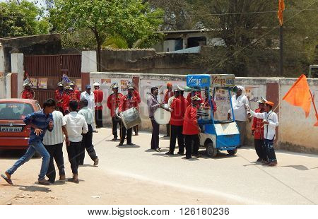 HYDERABAD,INDIA-APRIL 15:Band of indian musicians wait to lead the shoba yatra / procession of Hindu god sri Rama on sri Rama navami April 15,2016 in Hyderabad,India.