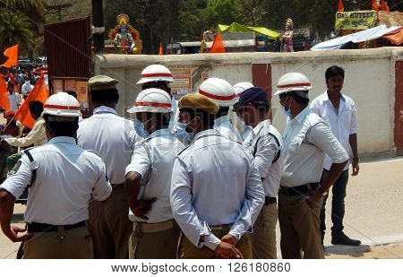 HYDERABAD,INDIA-APRIL 15: Indan Traffic police wait to follow shoba yatra procession of Hindu god Sri rama on navami festival on April 15,2016 in Hyderabad,India